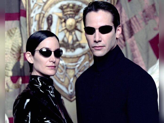 Kennen sich im neuen Teil nicht mehr: Carrie-Anne Moss und Keanu Reeves als Trinity und Neo in