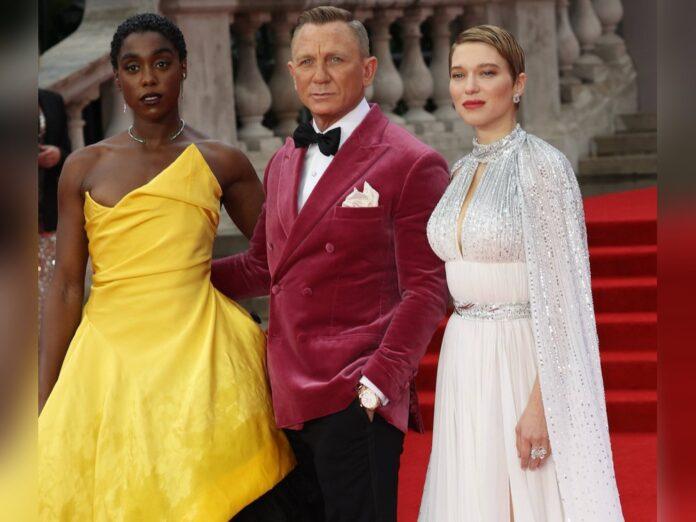 Daniel Craig (M.) auf dem roten Teppich neben seinen Co-Stars Lashana Lynch (l.) und Léa Seydoux.